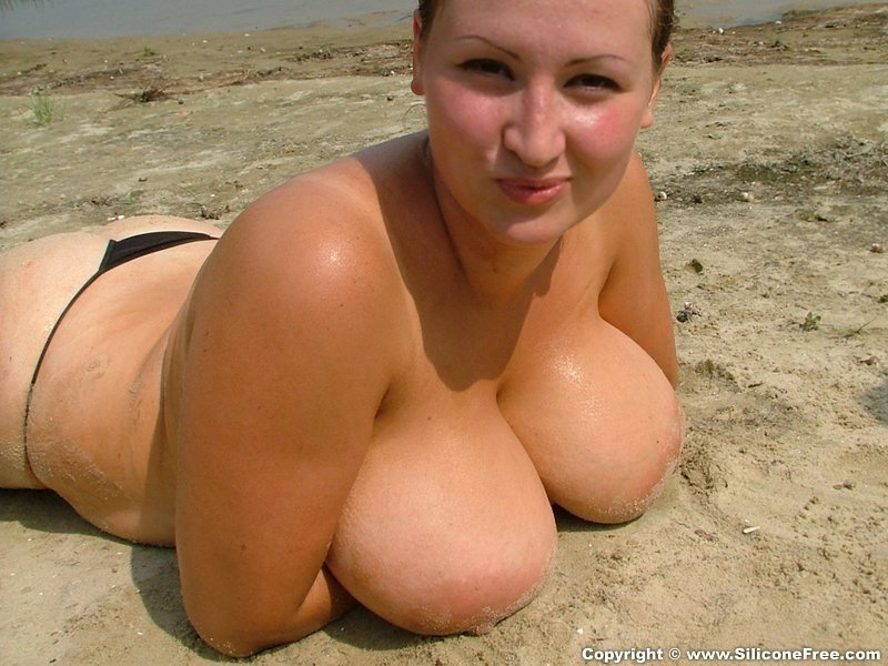 Big boobs pressed on the Sand